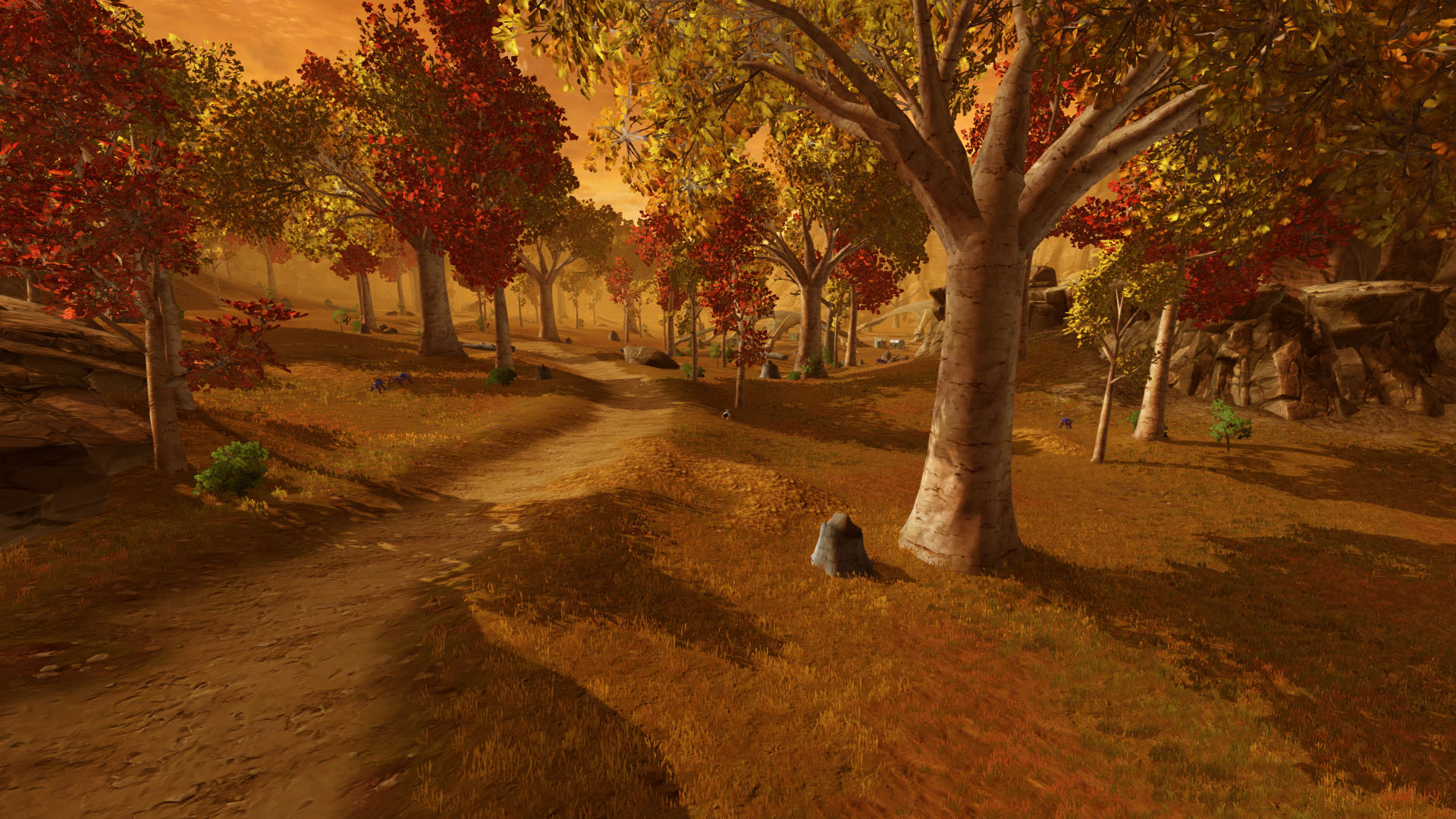 SWTOR screenshot taken in the northeastern part of the planet Voss. A road goes through the yellow-orange landscape with autumn trees and an orange sky