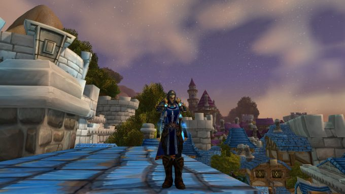 My oldest MMO character, my rogue, shows off her guild tabard in World of Warcraft